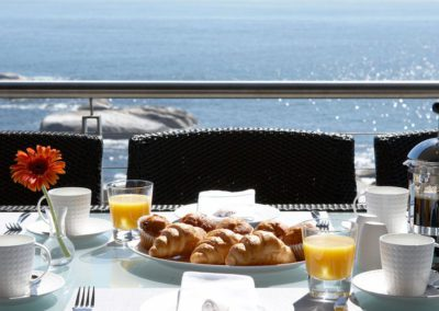 View-of-Sunset-Rocks-overlooking-Breakfast-Set-Up-on-the-Main-Deck
